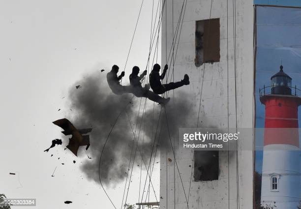 National Security Guard commandos display their skills during a function to celebrate the 34th NSG Raising Day at Manesar campus on October 16 2018...