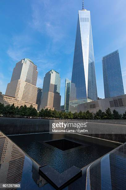 National September 11 Memorial And One World Trade Center Against Sky