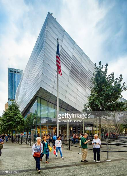 National September 11 memorial museum with American flag and tourists