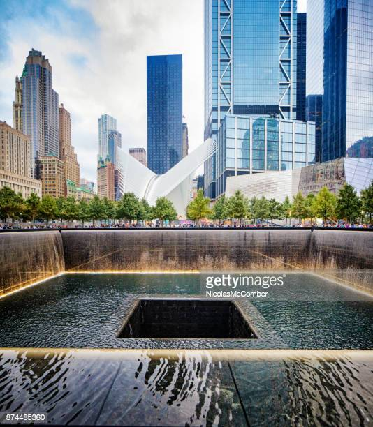 National September 11 memorial waterfalls with Oculus and surrounding buildings