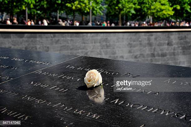 National September 11th Memorial Inscriptions, Visitors and Single Rose, NYC