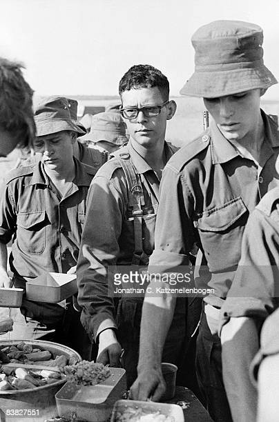 National Servicemen from A Company of the 7th Infantry Battalion of the South African Army queuing for food during a basic training exercise...