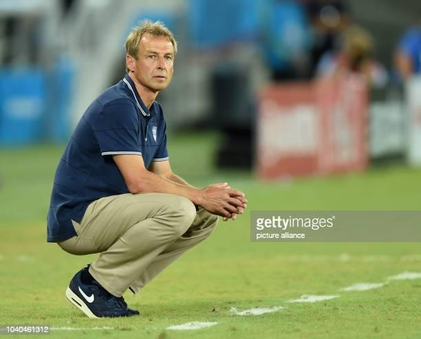 National soccer team's German head coach Juergen Klinsmann seen during the FIFA World Cup 2014 group G preliminary round match between Ghana and the...