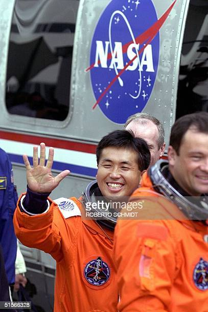 National Space Development Agency of Japana astronaut Koichi Wakata waves to well wishers and journalists 10 October 2000 prior to boarding the...
