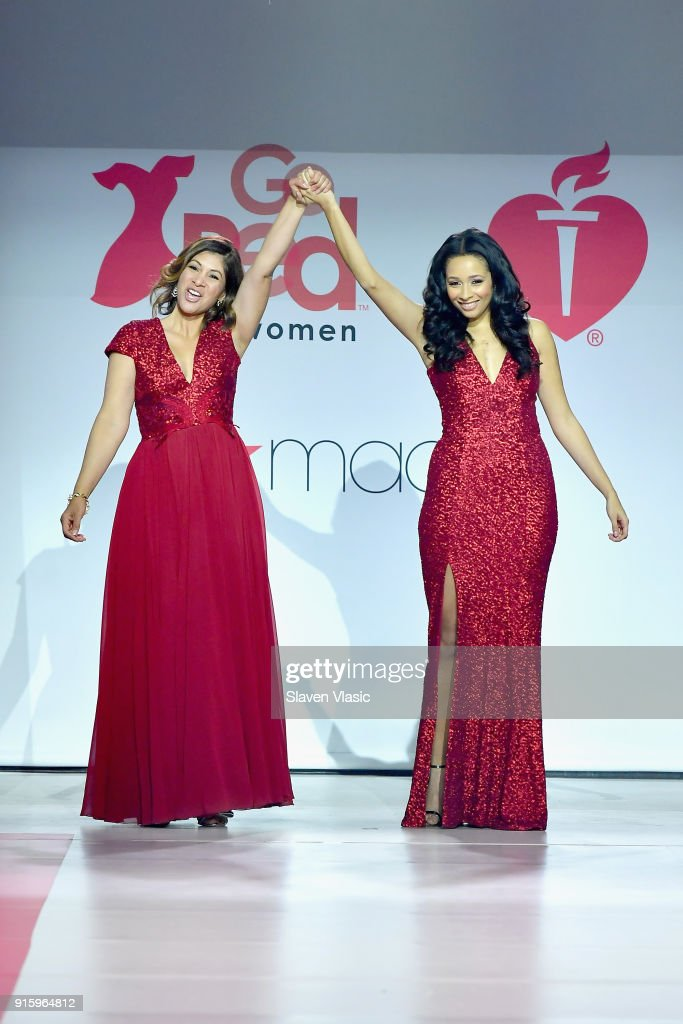 AHA national spokeswoman Lilly Rocha (L) and Karen A. Hill onstage at the American Heart Association's Go Red For Women Red Dress Collection 2018 presented by Macy's at Hammerstein Ballroom on February 8, 2018 in New York City.