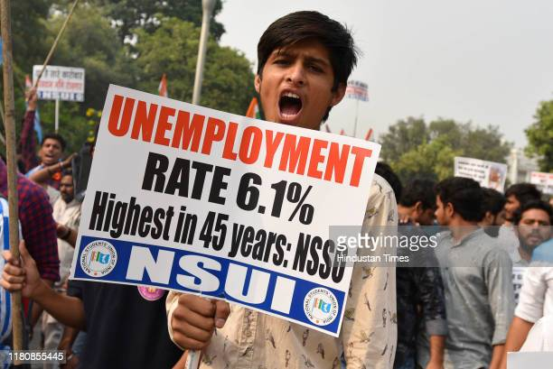 National Students Union of India members hold placards and shout slogans against Prime Minister Narendra Modi and Bharatiya Janata Party as they take...