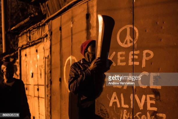 National Super Alliance protestor attempts to break into a storefront in the Kibera slum on October 26 2017 in Nairobi Kenya Protestors boycotted the...