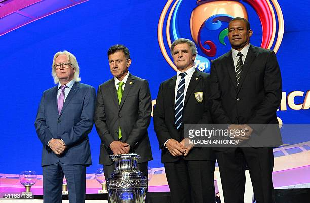 Jamaica's Winfried Schafer Mexcio's Juan Carlos Osorio Uruguay's assistant coach Celso Otero and Venezueal's Noel Sanvicente pose at the end of the...