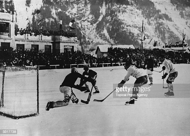 National teams from Canada and the USA in action during an ice hockey match at the Winter Olympic Games at Chamonix