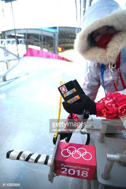 National Technical Official Chief of Temperature Control checks the temperature at the Luge start during previews ahead of the PyeongChang 2018...