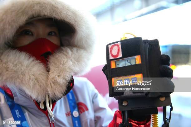 A National Technical Official Chief of Temperature Control checks the temperature at the Luge start during previews ahead of the PyeongChang 2018...