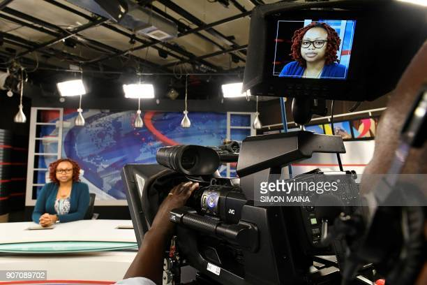 National Television Network Catherine Kariithi pose at the NTV studio of Kenyan 'Nation Media Group' in Nairobi on January 19 2018 / AFP PHOTO /...
