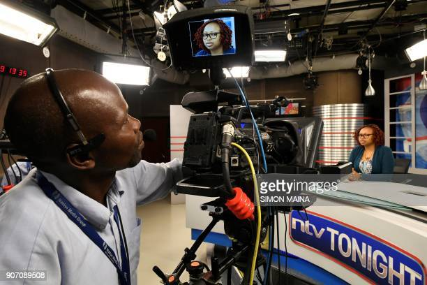 National Television Network's TV host Catherine Kariithi pose at the NTV studio of Kenyan 'Nation Media Group' in Nairobi on January 19 2018 / AFP...