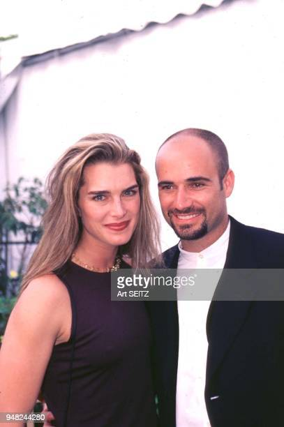 National Tennis Center Flushing Brooke Shields and Andre Agassi posed on their way to a reception for former US Open Champions during the 1997 US Open