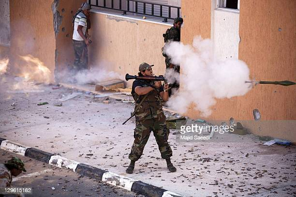 National Transitional Council fighter fires an RPG during a street battle in the 700 complex area of Emarat against Muammar Gaddafi's troops on...
