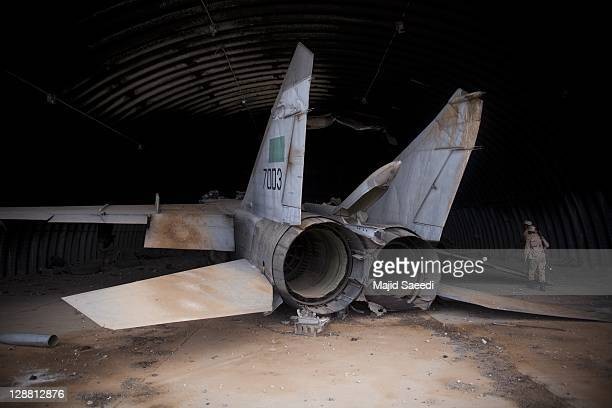 National Transitional Council fighters search the sirte airport which had been bombed by Nato Fighters on October 7 2011 in Sirte Libya National...