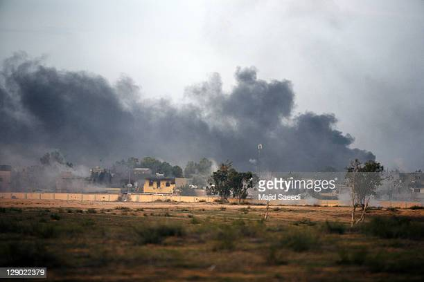 National Transitional Council fighters take part in a street battle in the 700 complex area of the city on October 9 2011 in Sirte Libya NTC fighters...