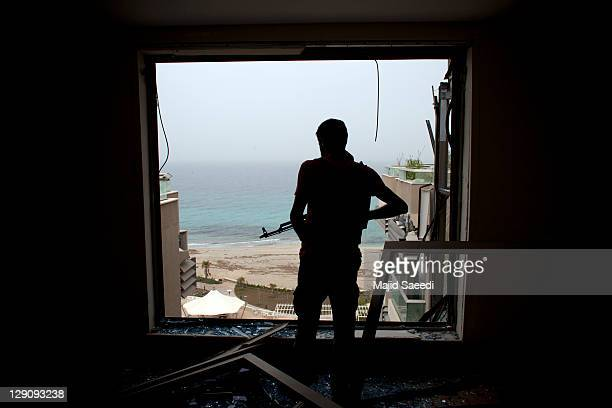National Transitional Council fighters take part in a street battle in the center of the city on October 12, 2011 in Sirte, Libya. NTC fighters say...