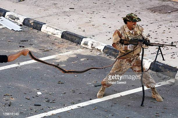 National Transitional Council fighters take part in a street battle in the 700 complex area of Emarat against Muammar Gaddafi's troops on October 8...