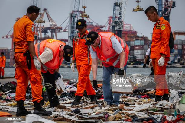 National Transportation Safety Board Boeing and Search and Rescue personnel check debris from Lion Air flight JT 610 at the Tanjung Priok port on...