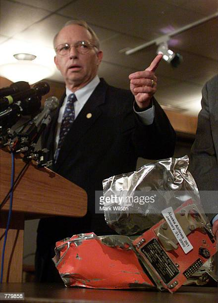 National Transportation Safety Board Chairman Jim Hall speaks at a press conference displaying the cockpit voice recorder from doomed Alaska Airlines...