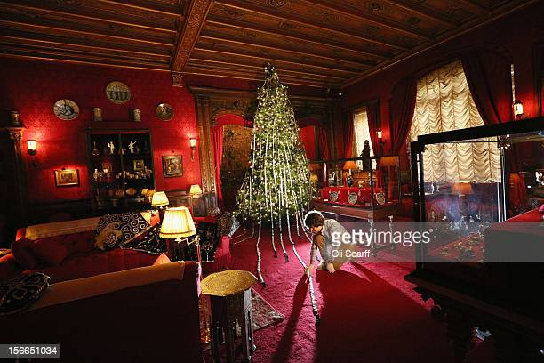 National Trust employee adjusts the Christmas decorations on a 'Pearly Kings and Queens' theme in the Smoking Room of Waddesdon Manor on November 16...