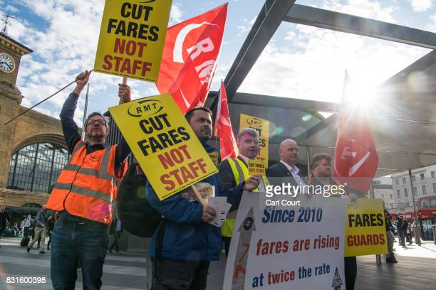 National Union of Rail Maritime and Transport Workers members take part in a protest against rail fare increases on August 15 2017 at King's Cross...