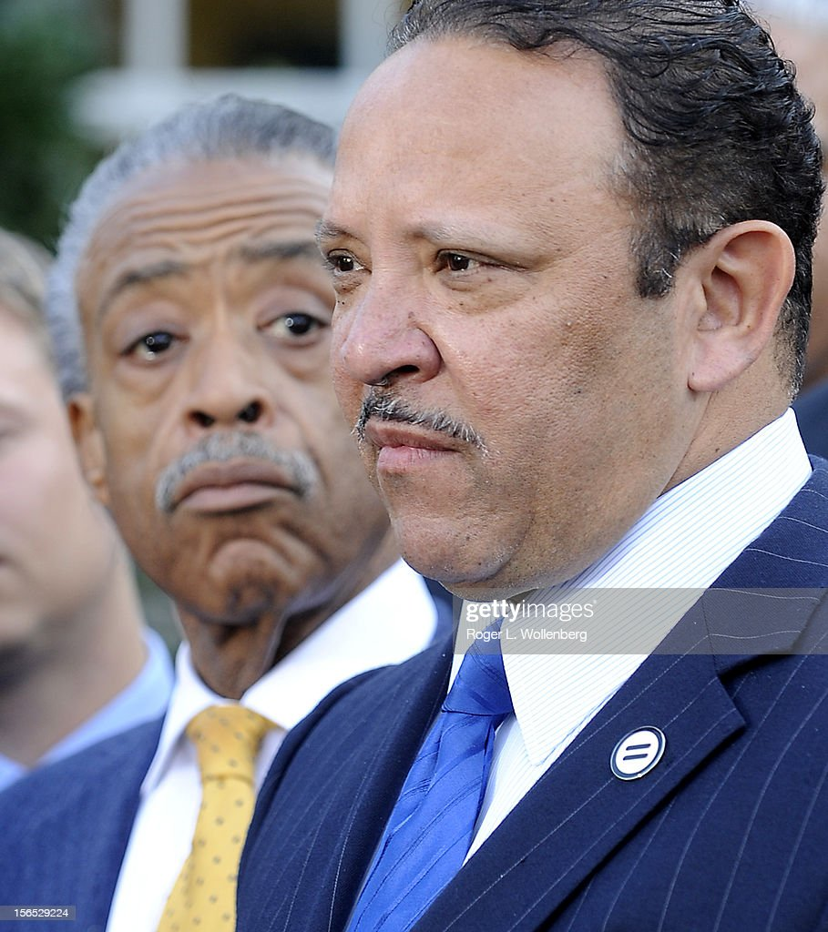 National Urban League President Marc Morial (R) speaks to the media as Rev. Al Sharpton looks on after leaders of civic organizations and other outside groups met with U.S. President Barack Obama at the White House on November 16, 2012 in Washington, DC. The meeting focused on economic concerns, taxes and health care.