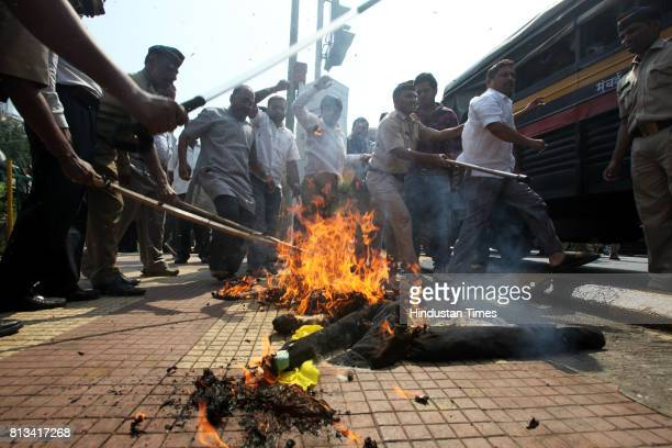 Nationalist Congress Party activists burnt an effigy of author Arundhati Roy over her remarks on Kashmir at Hutatma Chowk on Tuesday