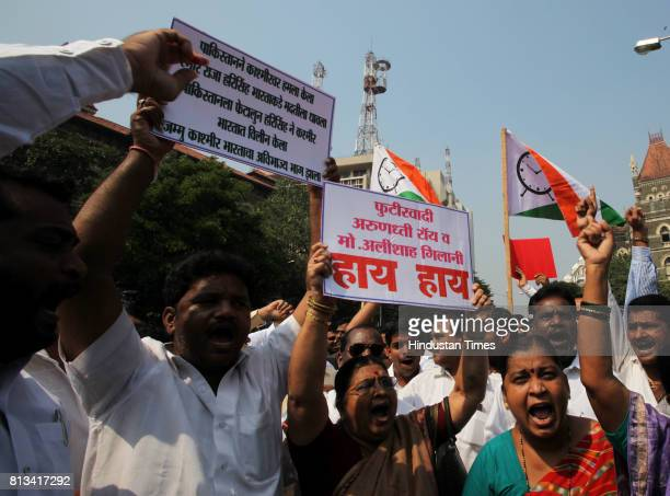 Nationalist Congress Party activists protest against Arundhati Roy over her remarks on Kashmir at Hutatma Chowk on Tuesday