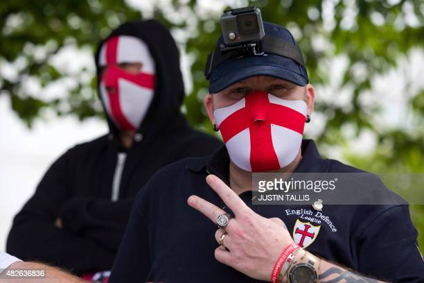 A nationalist counter demonstrator gestures as people rally to support migrants trying to cross into England through the channel tunnel from France...