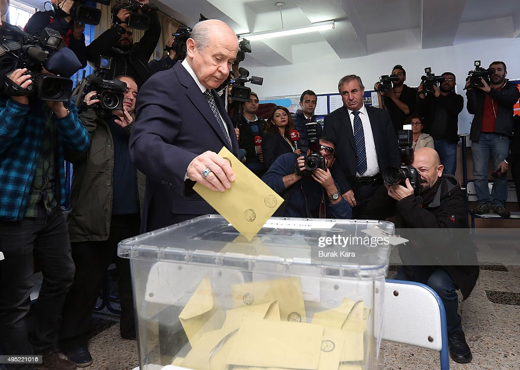 Nationalist Movement Party (MHP) leader Devlet Bahceli casts his vote at a polling station during a general election on November 1, 2015, in Ankara, Turkey. Polls have opened in Turkey's second general election this year, with the ruling Justice and Development Party (AKP) hoping to win a majority, as the country searches for stability amongst serious security concerns.