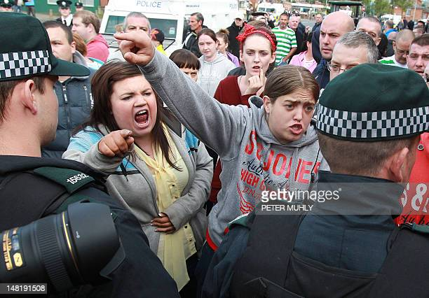 Nationalist protestors clash with police as Orangemen march past the Nationalist Ardoyne shops of North Belfast in Northern Ireland on July 12 2012...