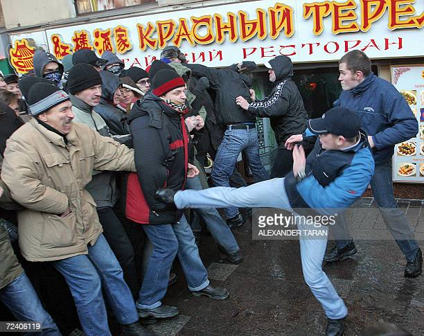 Nationalist protestors fight with antifascists during a rally marking National Unity Day in St Petersburg 04 November 2006 Nationalists began a...