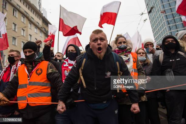 Nationalist shouting slogans during Independence Day. Thousands took part in an annual far-right march in Warsaw to mark Polands Independence Day,...