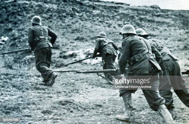 Nationalist soldiers advance with bayonets drawn during a battle in the Spanish Civil War