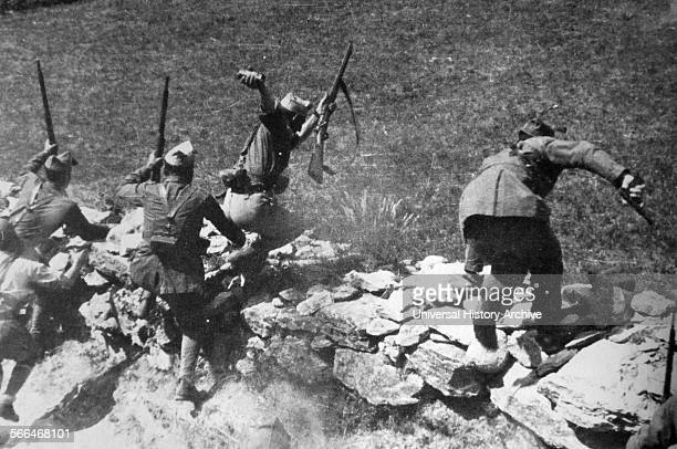 Nationalist soldiers in action during an assault on Madrid during the Spanish Civil War