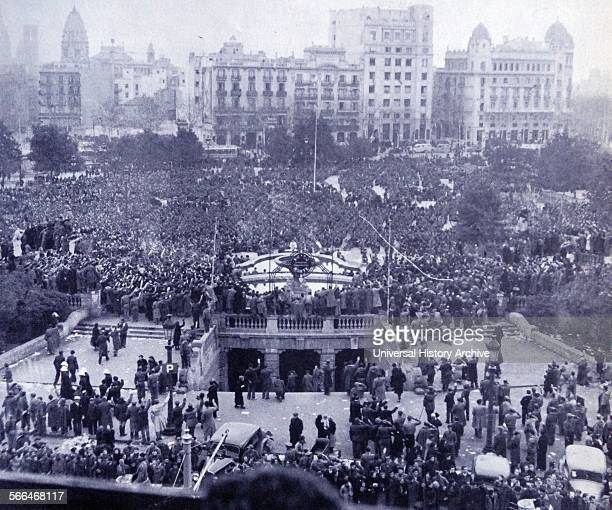 Nationalist supporters gather in Barcelona's Plaza de Cataluña after the fall of the city in 1939 during the Spanish Civil War