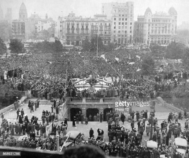 Nationalist supporters gather in Barcelona's Plaza de Cataluna after the fall of the city in 1939 during the Spanish Civil War