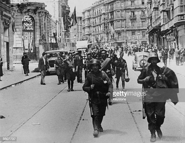 Nationalist troops on the streets of Bilbao after the fall of the city to Franco's forces during the Spanish Civil War, 19th June 1937.