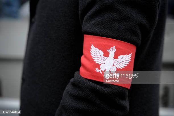 Nationalist wears a Polish eagle arm ribbon during the Independence Day March in Warsaw, Poland on November 11, 2019.