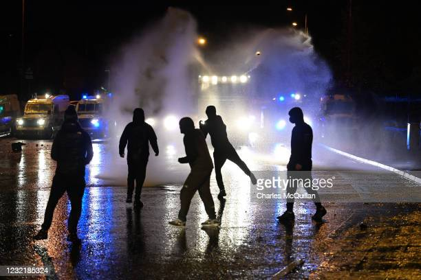 Nationalists attack police vehicles as they deploy water canons on Springfield Road just up from Peace Wall interface gates which divide the...