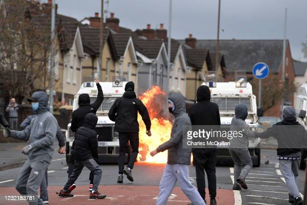 Nationalists attack Police vehicles on Springfield Road just up from Peace Wall interface gates which divide the nationalist and loyalist communities...