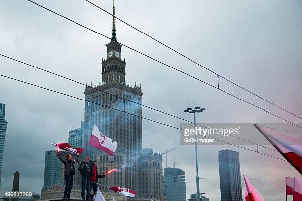 Nationalists light flares during the Independence Day March on November 11 2015 in Warsaw Poland The Independence Day March is organized by far right...