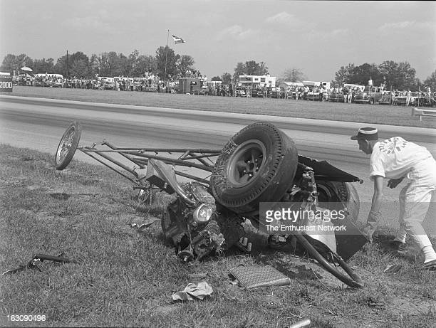 Nationals Drag Races Indianapolis Dragster loses control and crashes during a run Track worker goes about the business of clean up once medical...