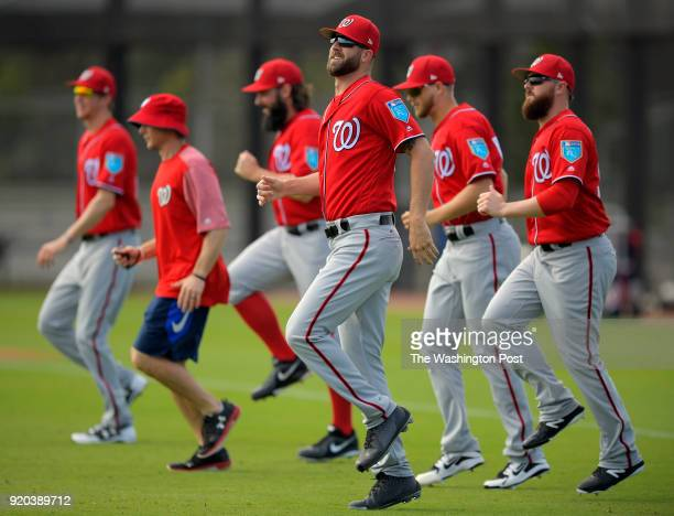 Nationals pitching prospect Bryan Harper center limbers up with other pitchers as the Washington Nationals pitchers and catchers participate in the...
