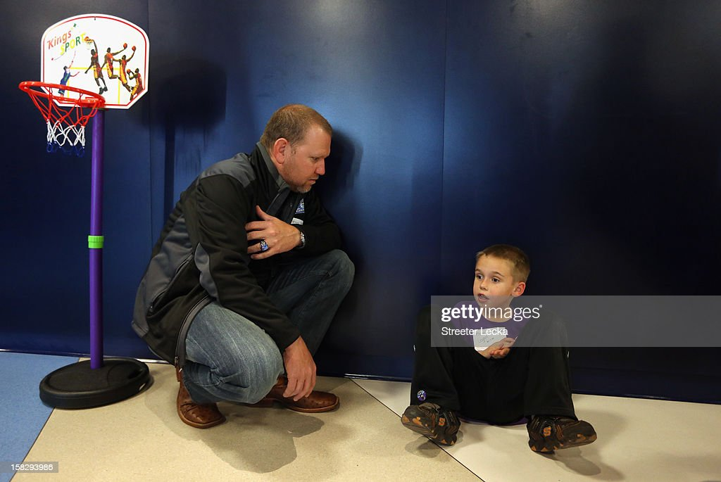 Nationwide Series Champion crew chief Mike Kelley talks with a young child at the Nationwide Children's Hospital during the NASCAR Nationwide Series Champion's Day on December 12, 2012 in Columbus, Ohio