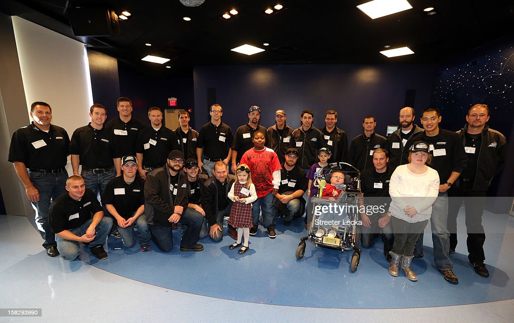 Nationwide Series Champion team members pose for pictures at the Nationwide Children's Hospital during the NASCAR Nationwide Series Champion's Day on December 12, 2012 in Columbus, Ohio