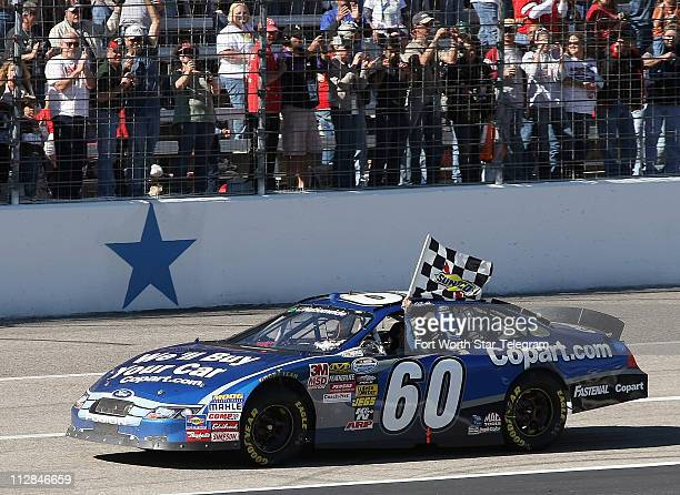 Nationwide Series driver Carl Edwards celebrates his victory in NASCAR Nationwide Series O'Reilly Auto Parts Challenge at Texas Motor Speedway in...