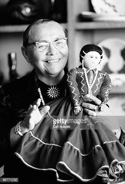 Native American activist and educator Annie Dodge Wauneka smiles as she holds up a Zuni doll that she plans to present to President Kennedy's...
